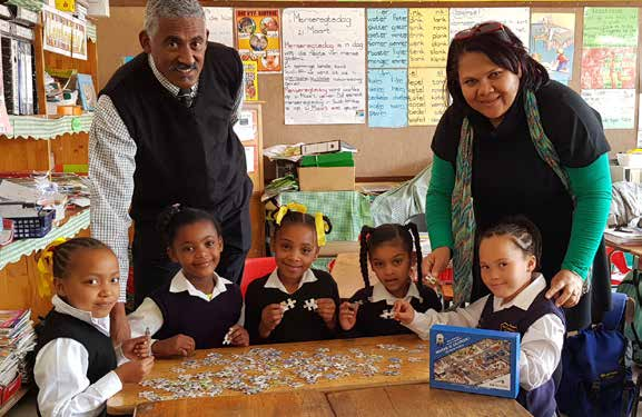 Learners of the Kretzenhoop Primary School enjoy building the 120-piece GO GEORGE puzzle.