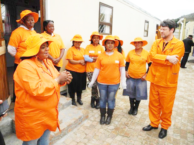 Deputy Minister Andries Nel with some Community Work Programme beneficiaries.