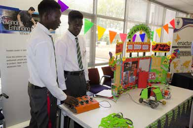 Trevor Simelane and Joseph Mdluli with their award-winning fire rescue robot.