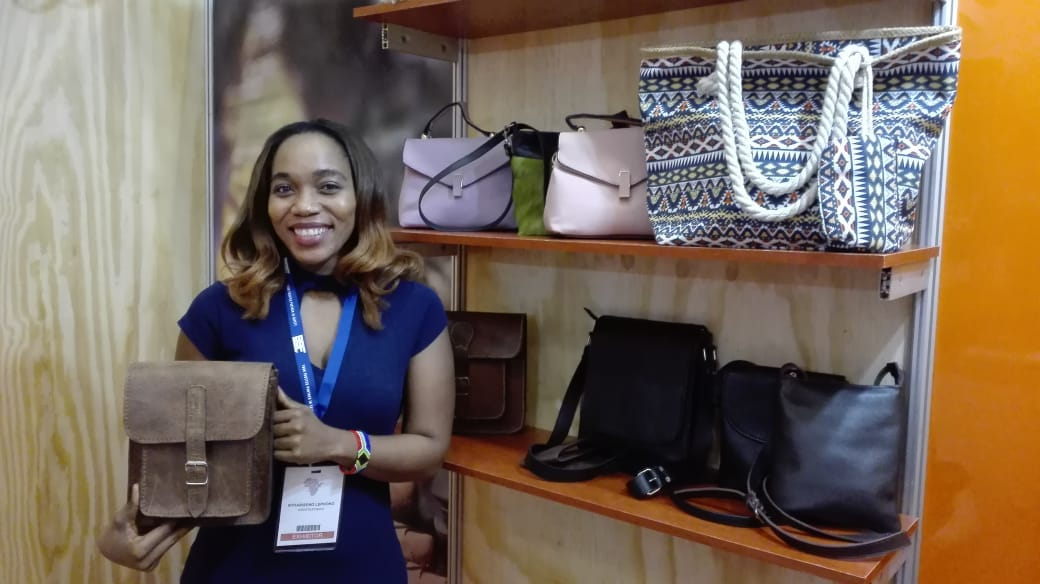 Textile designer and businesswoman Nthabi Lephoko with one of the leather bags she designed. Lephoko owns Leratolethato, a leather design and manufacturing company based in Cape Town.