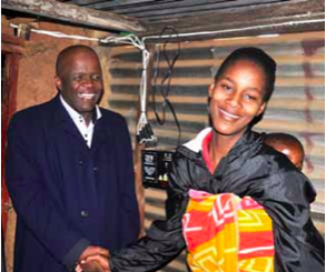 Photo caption: Ekurhuleni Executive Mayor Mondli Gungubele shares a moment with resident Ann Van Heerden, who is all smiles after she became one of the beneficiaries of a solar lighting project.
