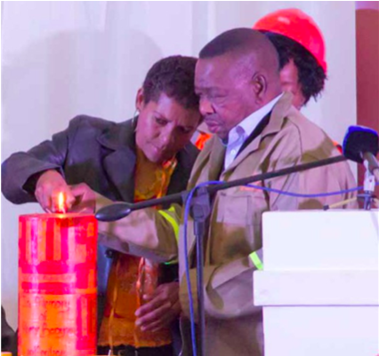 Photo caption: Higher Education Minister Blade Nzimande lights a candle in memory of murdered Bredasdorp teenager Anene Booysen. The Minister also announced a skills development project in Booysen's memory that would benefit Bredasdorp youth.