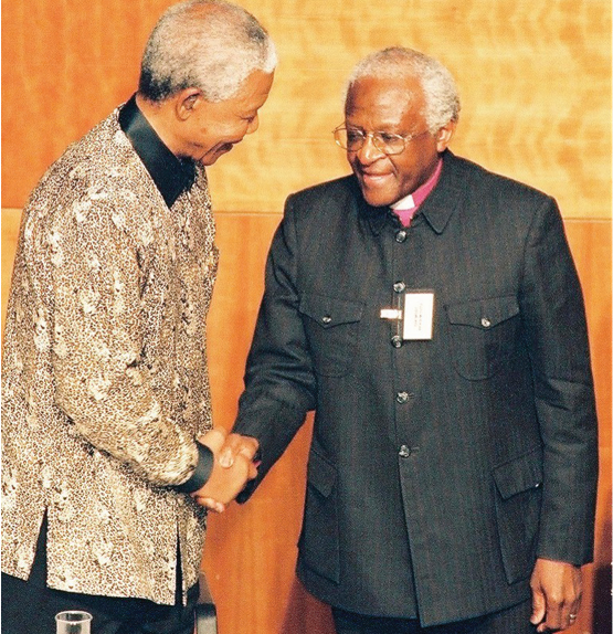Former President Nelson Mandela with the chairperson of the Truth and Reconciliation Commission Archbishop Desmond Tutu.