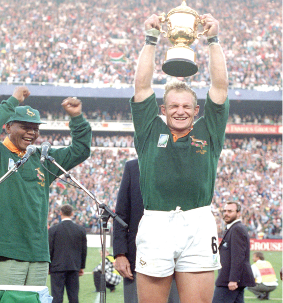 Photo caption: Former President Nelson Mandela celebrates with former Springbok captain Francois Pienaar after the team won the 1995 Rugby World Cup.
