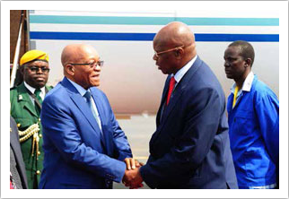 Zimbabwean Finance Minister Patrick Chinamasa welcomes President Jacob Zuma on arrival at the Victoria Falls International Airport.