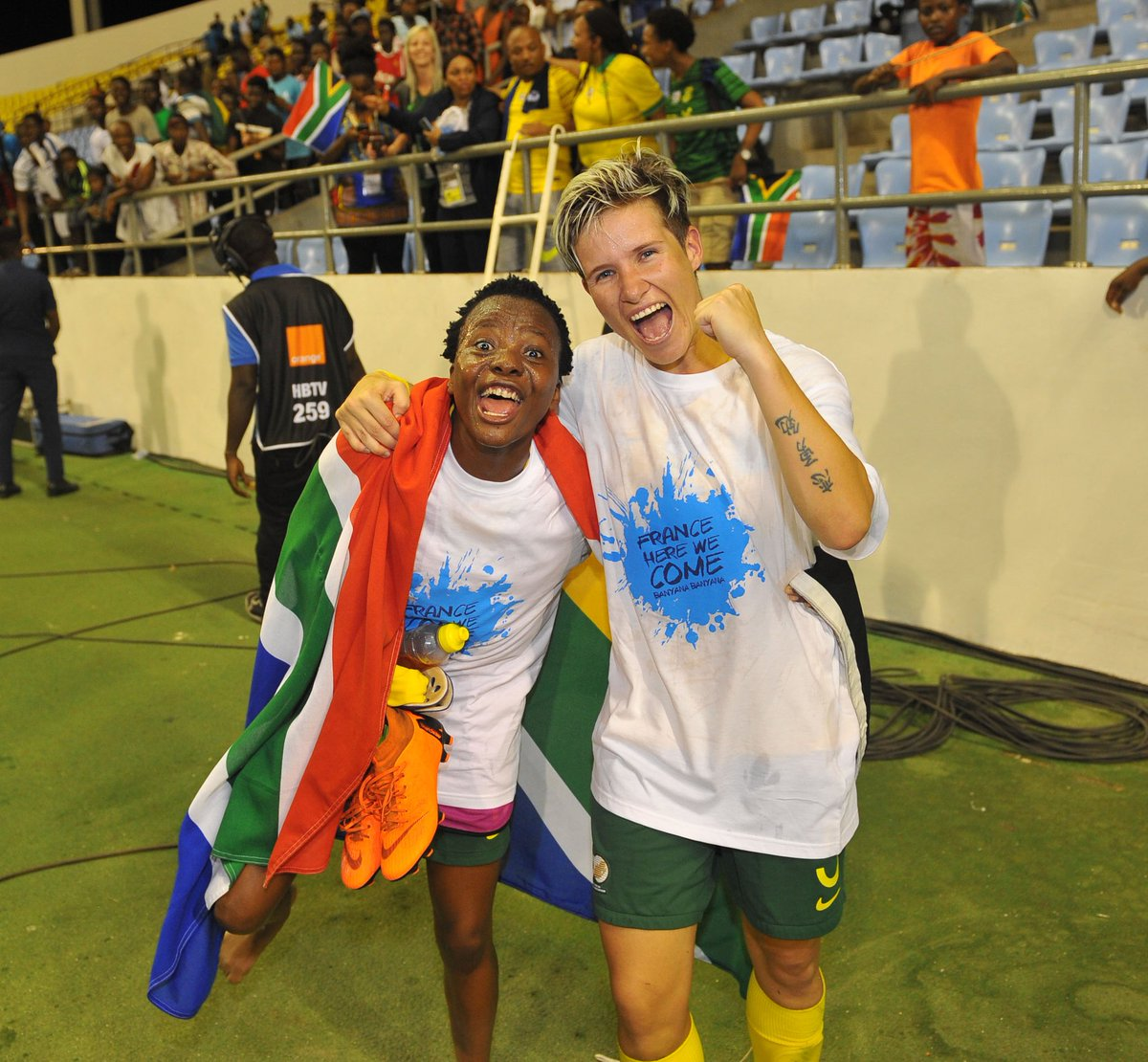 Banyana Banyana striker Thembi Kgatlana and Captain Janine van Wyk celebrate their win against Mali in the AWCON semi-final and qualifying for the FIFA Women's World Cup in France next year.
