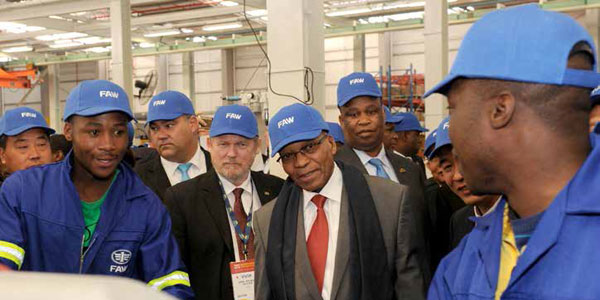 President Jacob Zuma and Trade and Industry Minister Rob Davies interact with workers during the official launch of the First Automotive Works (FAW) assembly plant in the Eastern Cape.