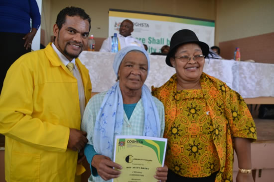 Premier of the Northern Cape Sylvia Lucas (right) and MEC for Cooperative Governance, Human Settlements and Traditional Affairs Alvin Botes with Mary Miles who received a house from the provincial government.