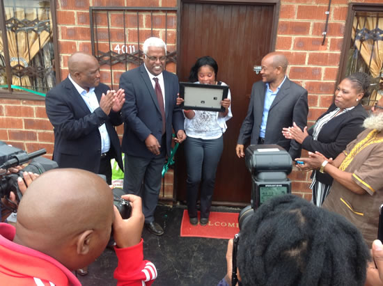 Nomalungelo Mkhize looking at her certificate confirming her ownership of the house at Sithembile, Glencoe northern of KwaZulu-Natal.