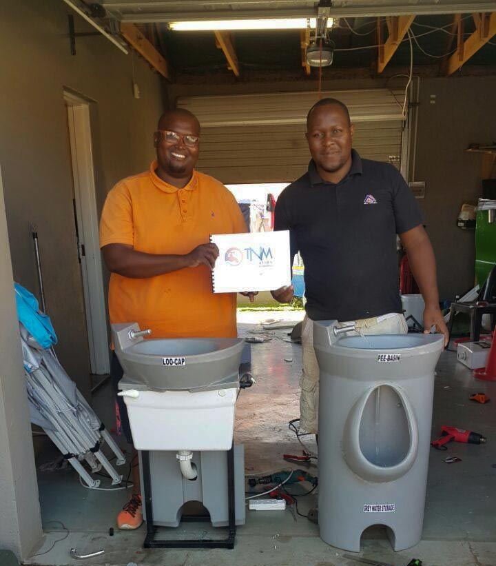 Rori Mpete (left) and Thoriso Thobejane with the Loo Cap and the Pee Basin.