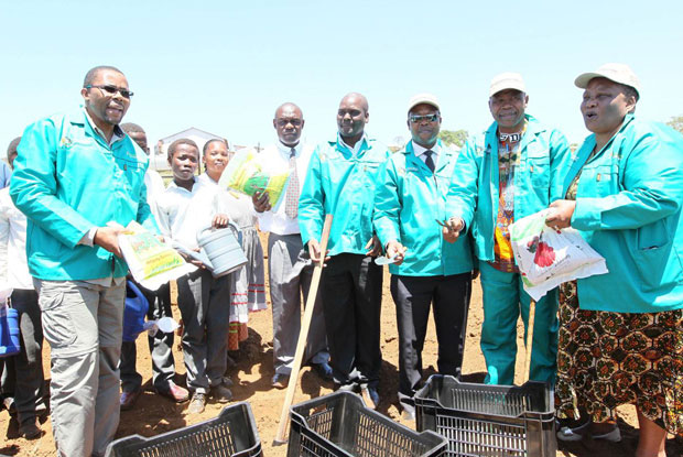 MEC Cyril Xaba hands over seeds and other equipment that the cooperative members will need to run their projects.