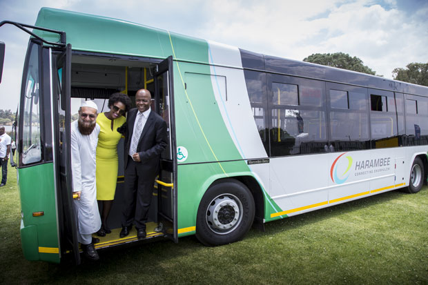 Gauteng MEC for Roads and Transport Ismal Vadi, seen here with Ekurhuleni Mayor Mondli Gungubele (far right), testing one of the Harambee buses.