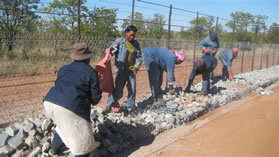 Local people were employed to erect a fence on the border between Muyexe village and the Kruger National Park to protect the community and their livestock