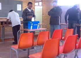 Parents casting their votes during a school governing body election.