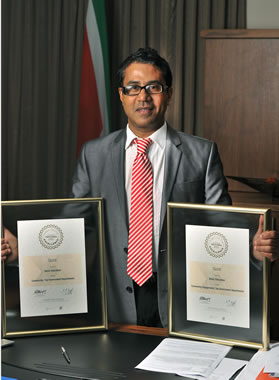 Director-General of Basic Education Bobby Soobrayan proudly displays the department's awards.