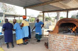 Women at the Vuka-uzenzele Project prepare dough at the Sehlulile Primary School in Matsulu outside Mbombela.
