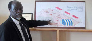 Principal Phiwayinkosi Ngubane points to a drawing of how Nkombose High School looked before the new school was built.