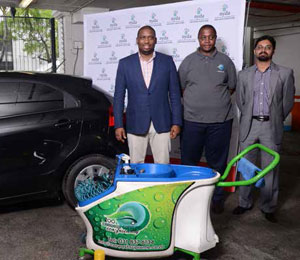 Deputy Minister in The Presidency, Buti Manamela, Carwash Supreme owner Mbongeni Msomi and NYDA Executive Chairperson Yershen Pillay seen here with the equipment used to wash cars.