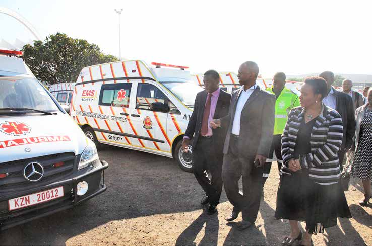 KZN Health MEC Dr Sibongiseni Dhlomo (centre) inspects the ambulances.