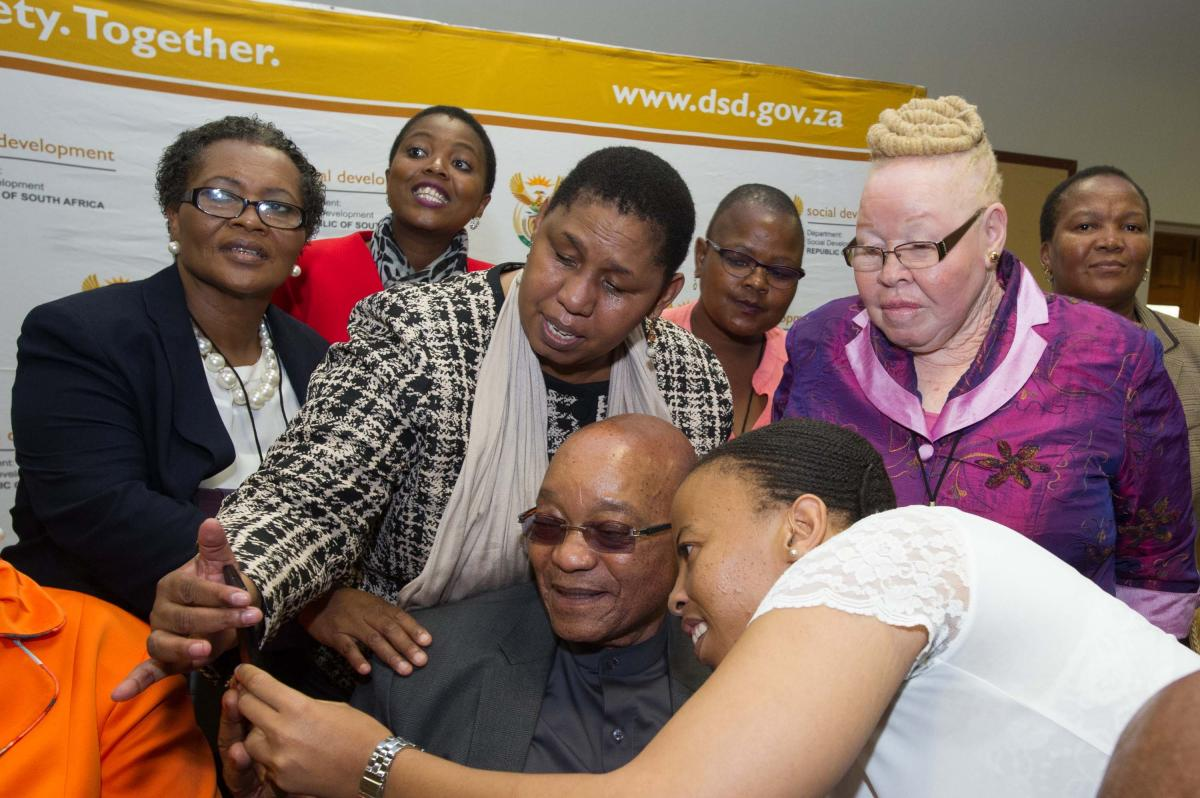President Jacob Zuma and Social Development Deputy Minister Hendrietta Bogopane-Zulu (centre) interacting with delegates at the Presidential Working Group on Disability during Human Rights Month in March.