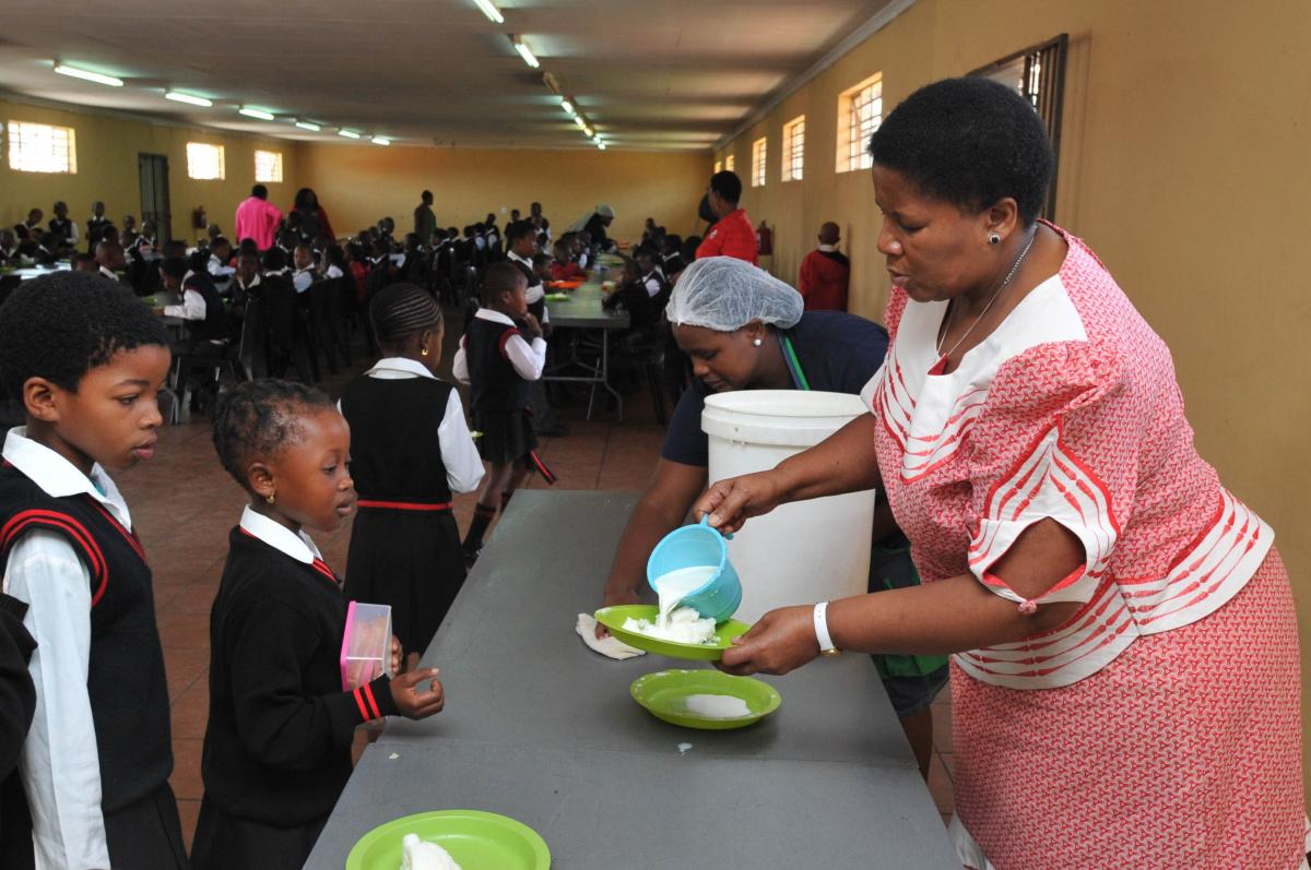 Mogobeng Primary School principal Mateta Marokoane serving lunch to some of the learners.