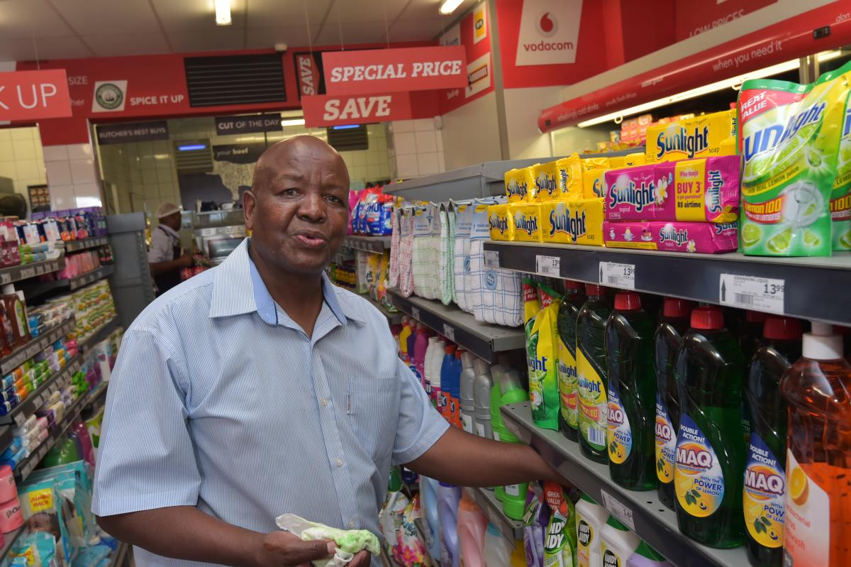 Solly Legae of Monageng Supermarket packing stock at his shop in Diepkloof. Monageng Market store has seen an increase in sales since becoming part of the pilot programme.
