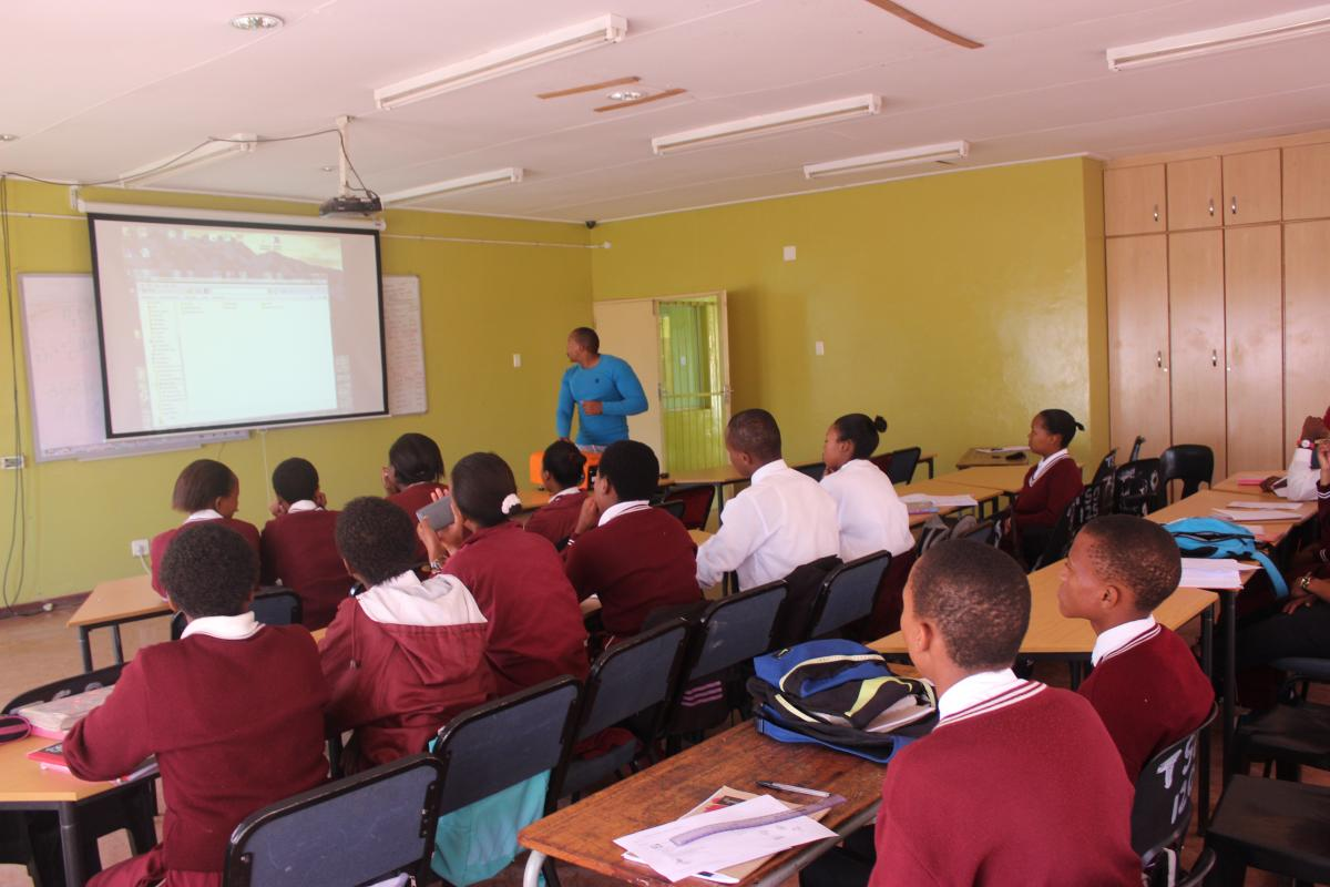 Learners at Tsoseletso Secondary School, Free State listen to English teacher Kamohelo Mongwenyane. The school now uses technology to teach lessons.
