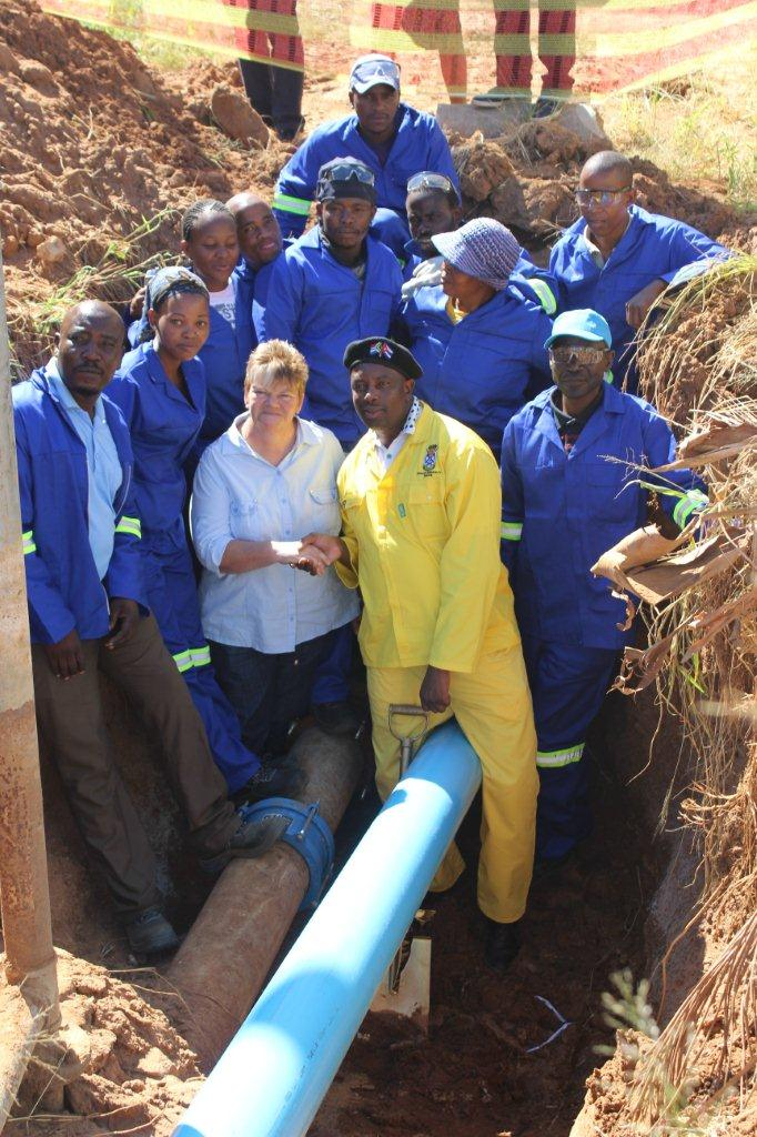 Lephalale Mayor Jack Maeko (middle) inspecting new asbestos pipes. Residents of Lephalale Municipality will enjoy better quality water because of the infrastructure upgrade. upgrade.