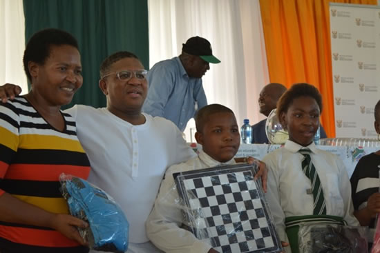 Minister Fikile Mbalula with recipients of the sport equipment handed over at the department's outreach programme.
