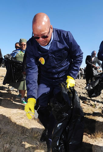 President Jacob Zuma cleaning the streets of Mvezo in the Eastern Cape as part of the previous Nelson Mandela International Day activities.