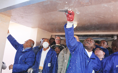 Deputy President Cyril Ramaphosa with Premier Supra Mahupeloa and Minister Pravin Gordhan leading the cleaning campaign in Mafikeng Hospital, in the North West Province during the previous Nelson Mandela International Day activities.