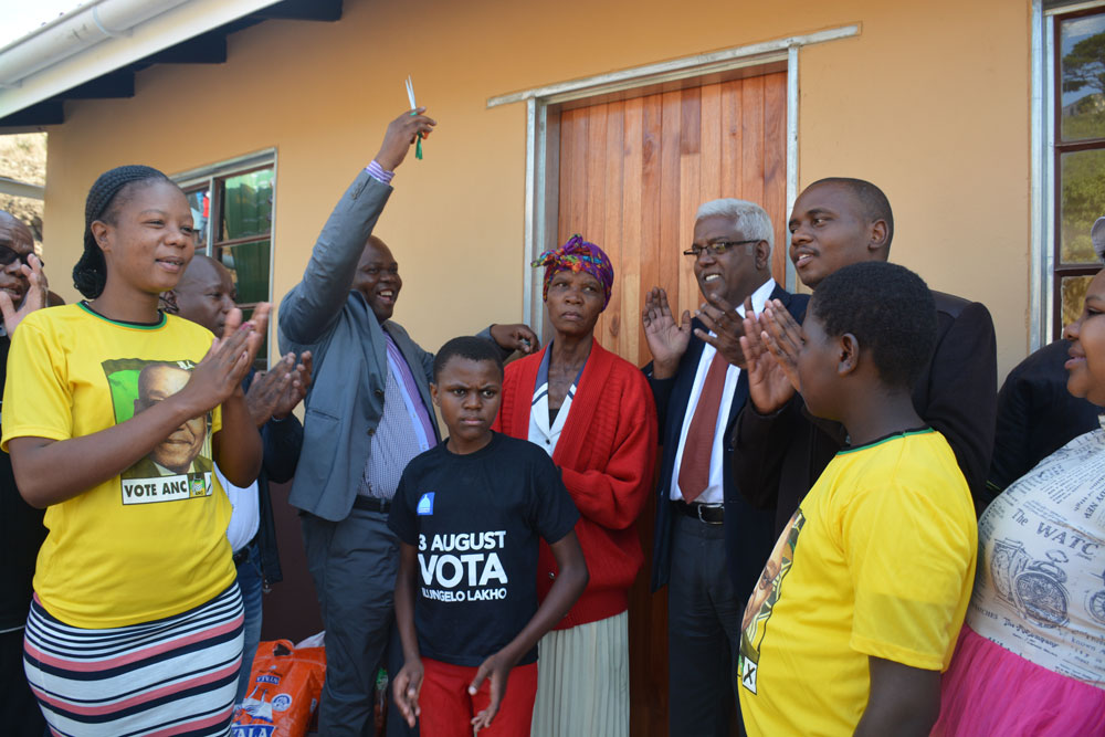 Vulamehlo Municipality's Executive Mayor Councillor Thabani Dube and Human Settlements and Public Works MEC Ravigasen Pillay hand over a house to Ntombizonke Maphumulo.