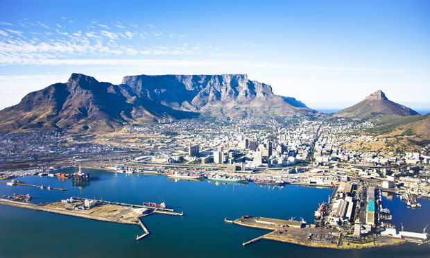 Aerial view of Cape Town city centre, with Table Mountain, Cape Town Harbour, Lion's Head and Devil's Peak.