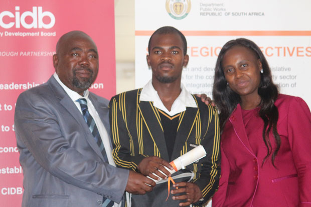 Olwethu Bitterhout's (centre) hard work has paid off. Public Works Minister Thulas Nxesi (left) handed him a bursary that will pay for his studies at the University of Cape.