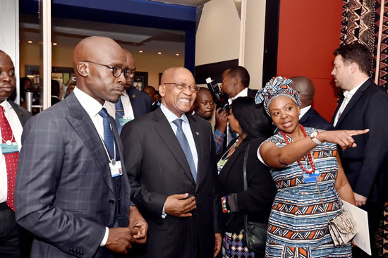 President Jacob Zuma accompanied by Minister of Finance Malusi Gigaba and head of WEF Elsie Kanza at the World Economic Forum on Africa meeting in Durban.