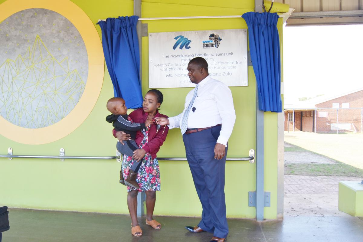 From left to right: Two-year-old Lubanzi Luthuli with her mother Sinenhlahla Mlondi and the CEO of Ngwelezana Hospital, Dr Bright Madlala at the newly opened Paediatric Burns Unit
