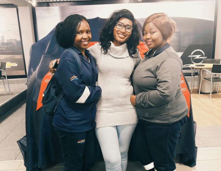Owner of Malitinne Sibusisiwe Kraai (middle) with two students that have benefitted from the company's in-service placement programme. On the left is Ziningi Moyeni and on the right is Thwalani Dlamini.