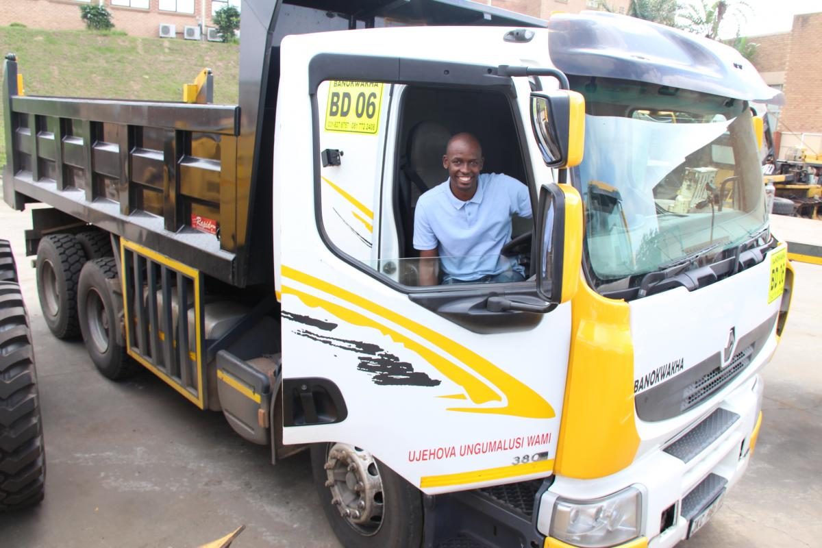 Sandile Ntuli test driving one of his trucks at their office in Pinetown, west of Durban.