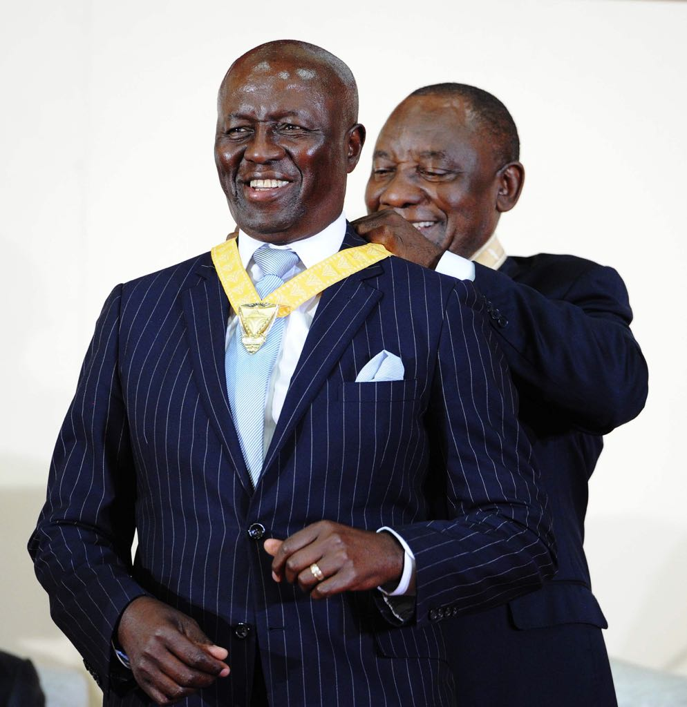 President Cyril Ramaphosa bestowing Justice Dikgang Moseneke with the Order of Luthuli in Gold.