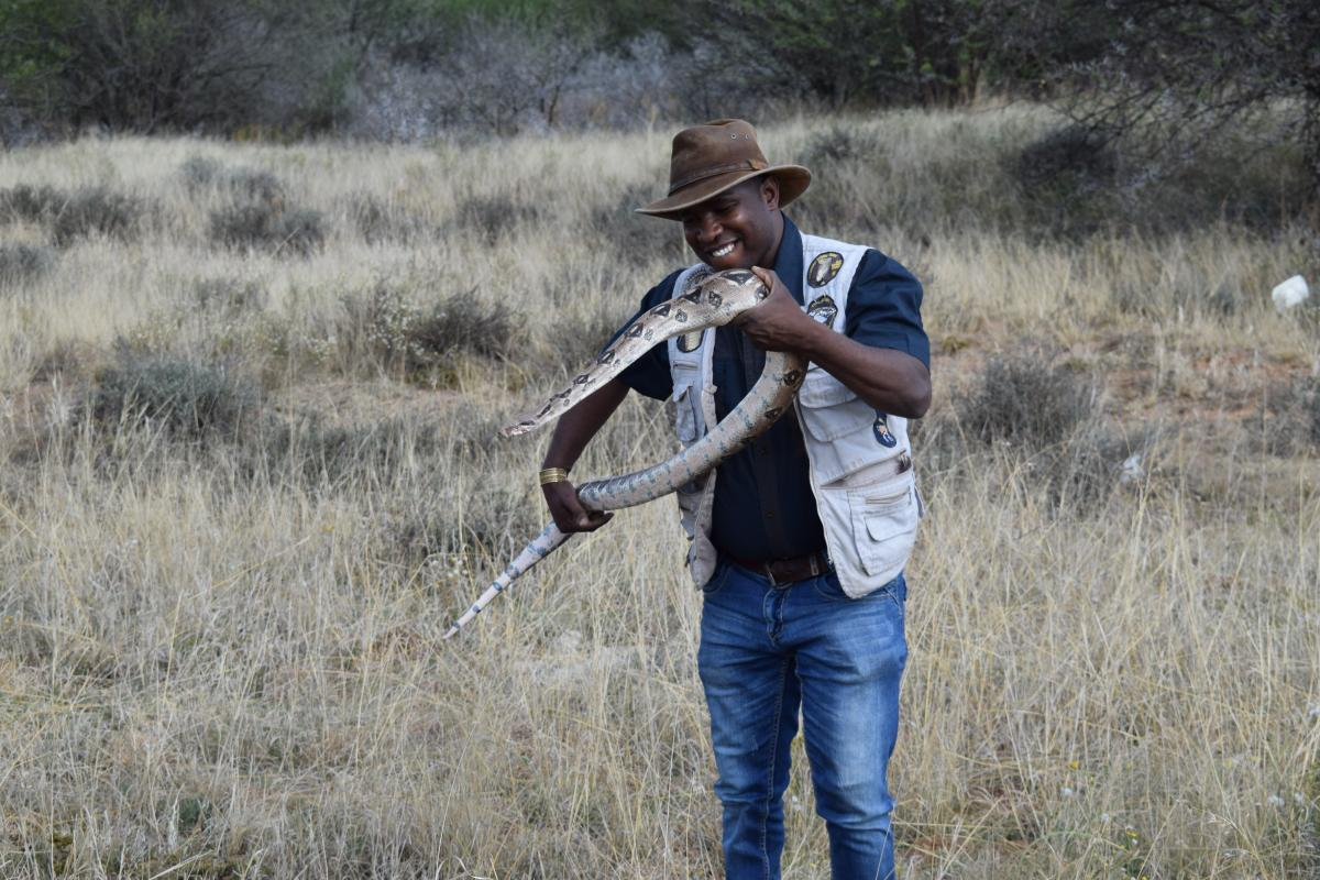 Herpetologist Harry Baloyi with his pet Cecilia.