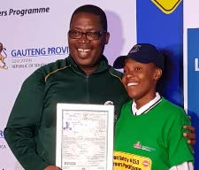 Gauteng MEC Panyaza Lesufi hands over a learner's licence certificate to one of the pupils who benefitted from the K53 learner's licences programme.
