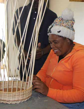 Dory Zuma, who is blind, weaving a cane basket at the Shiyase Disabled Craft Primary Cooperative in Mooi River, KwaZulu-Natal.