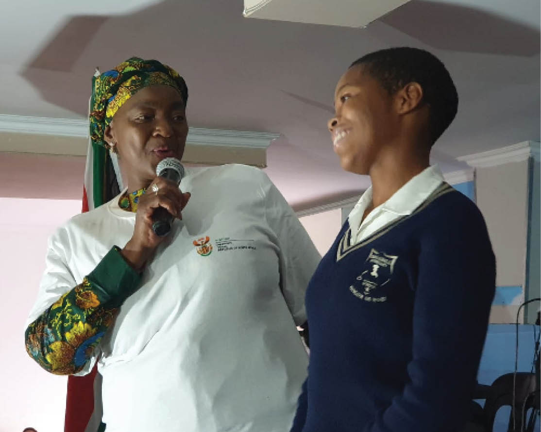 Minister of Women Bathabile Dlamini with one of the learners of Nkonkoni Primary School in Umlazi during the launch of the Sanitary Dignity Framework Programme.