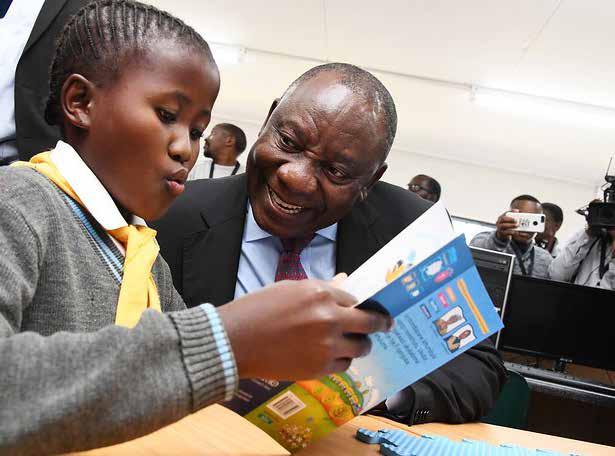 President Cyril Ramaphosa with a Grade 1 learner from the newly opened Enhlanhleni Primary School in Dannhauser near Newcastle in KwaZulu-Natal.