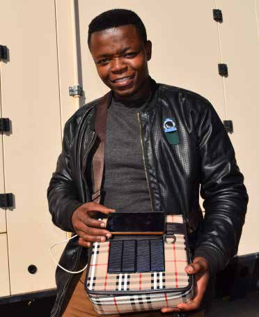 Tumelo Photolo with his first invention.