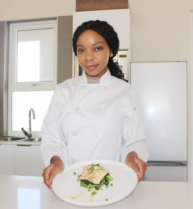 Chef Leigh-Ann Modise with her favourite vegetables and fish meal.