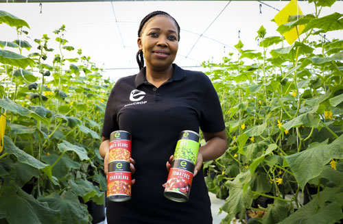 Hydroponic fruit and vegetable farmer Ntando Thabethe with some of her canned vegetables.