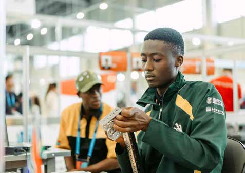 Tshwane University of Technology student Tebogo Moleha (in green jacket) during the WorldSkills Competition in Russia.