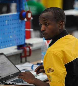 Thabang Modise working on his laptop at the WorldSkills Competition.