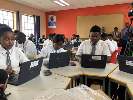 Pupils of Soshanguve East Secondary School getting a feel of the new study tool during the launch of the Digital Content and Online Assessment Platform.